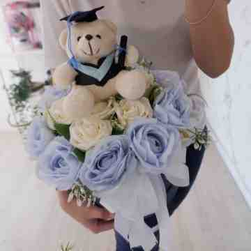 Winter Blue Artificial Bloombox with Graduation Doll